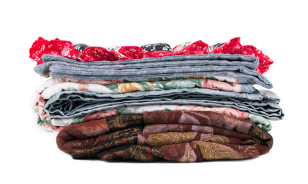 Stack of beautiful handmade quilts. photo