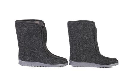 valenki: Pair of black felt boots. Isolated on a white background. Stock Photo