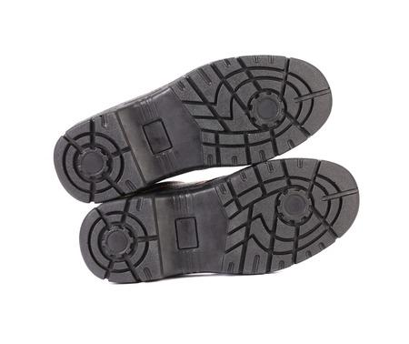 zapatos de seguridad: Suela de zapato negro. Aislado en un fondo blanco. Foto de archivo