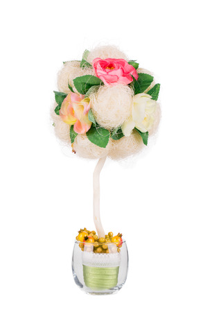 Handmade artificial flower. Isolated on a white background. photo