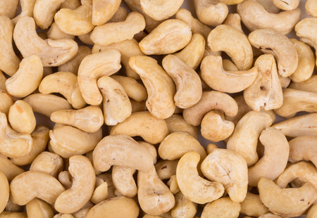 Close up of cashew nuts. Whole background. photo