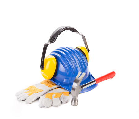 Hard hat and ear muffs hammer. Isolated on a white background. photo