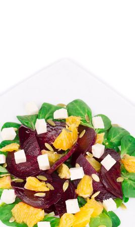 cubed: Beet salad with feta cheese and orange. Isolated on a white background.