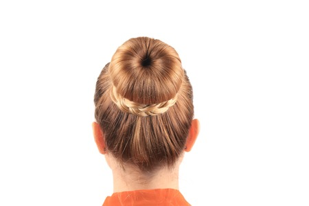 Beautiful woman with creative elegant hair bun. Isolated on a white background. photo