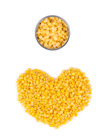 Heart shape of canned corn. Isolated on a white background. photo