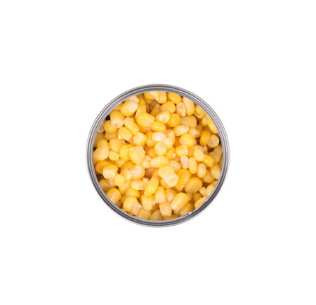 Fresh corn in can. Isolated on a white background. photo