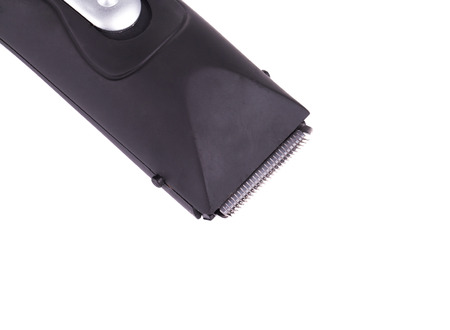 Close up of electric razor. Isolated on a white background. photo