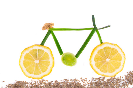 Bicycle from lemon and onion. Isolated on a white background. photo