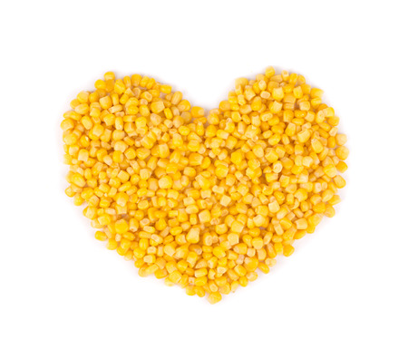 Heart made of corn. Isolated on a white background. photo