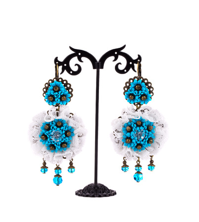 Earrings on a stand. Isolated on a white background. photo