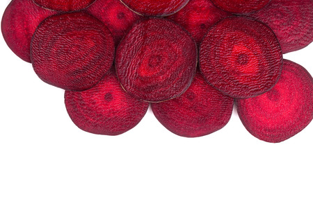 sliced  �  �  �  �: Closeup of tasty sliced beet. Whole background. Stock Photo