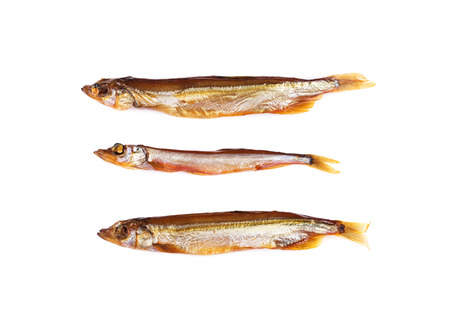 Smoked three fishes. Isolated on a white background. photo