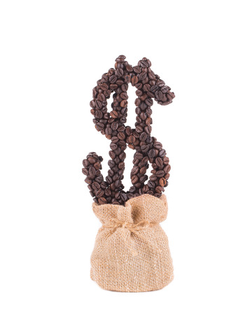 Coffee dollar growing of burlap sack. Isolated on a white background. photo