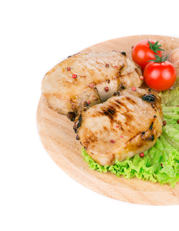 Grilled pork with vegetables. Isolated on a white background. photo