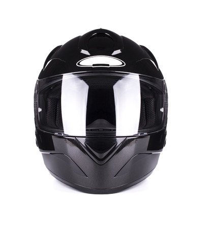Black full face motorcycle helmet. Isolated on a white background. photo