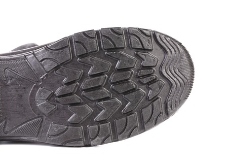 Black rubber shoe sole. Isolated on a white background.