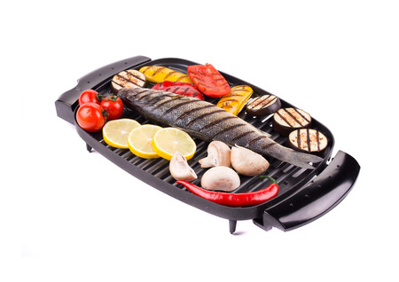 Grilled seabass on grill with vegetables. photo