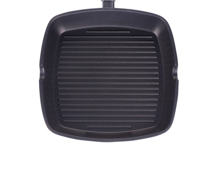 Black frying pan. Isolated on a white background. photo