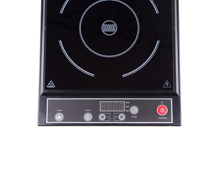 Modern electric stove surface. Isolated on a white background. photo