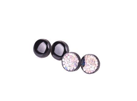 white backing: Earrings colorful set.  Stock Photo