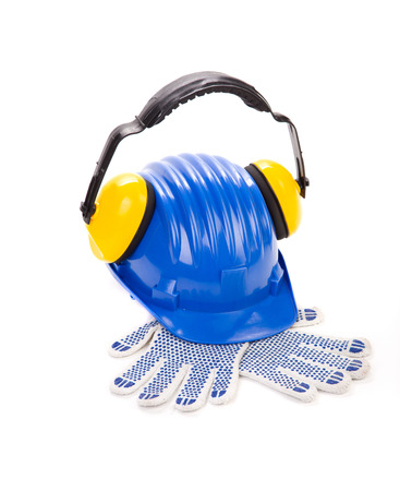 Hard hat and ear muffs with gloves. Isolated on a white background. photo