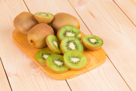 Kiwi fruits cut and whole. photo
