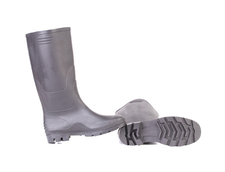 High rubber boots black color. Isolated on a white . photo