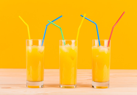 Close up of glasses full of orange juice. photo