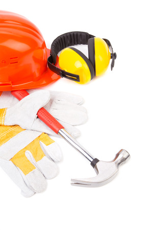 Red helmet and working tools. Isolated on a white background. photo