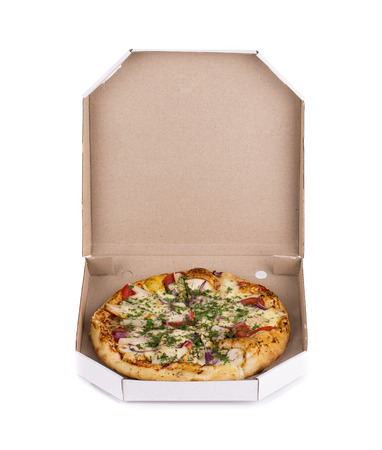 Pizza in box. Isolated on a white background. photo