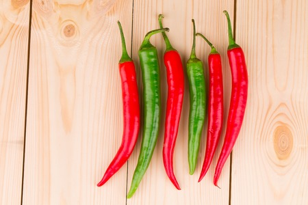 Red and green chili pepper. Whole background. photo