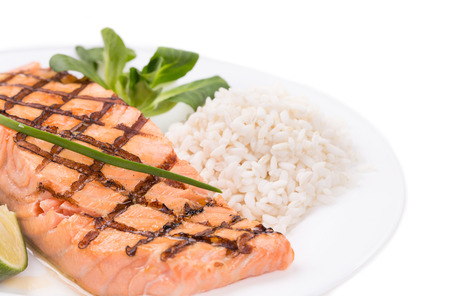 Grilled salmon filler with risotto. Whole background. photo