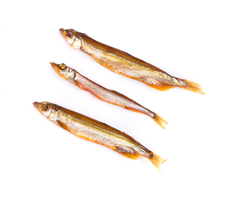 Three smoked fish. Isolated on a white background. photo