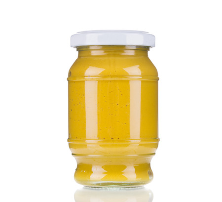Glass jar full of mustard.  Isolated on a white background. photo