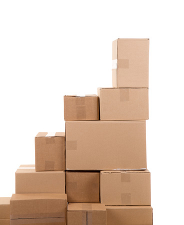 packing boxes: Stack of empty boxes. Isolated on a white background. Stock Photo