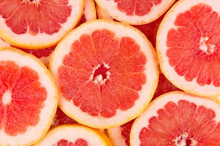 Close up of sliced grapefruit as a background.