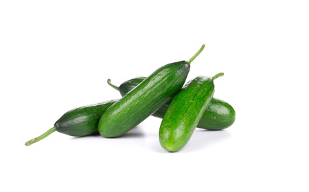 cuke: Four fresh cucumbers. Isolated on a white background. Stock Photo