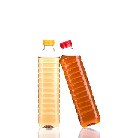acetic acid: Bottles full of vinegar. Isolated on a white background.