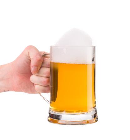 Hand holding mug of beer. Isolated on a white background. photo