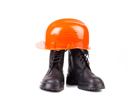 Hard hat and working boots. Isolated on a white background. photo