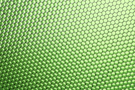 Honeycomb grid against green background close up photo