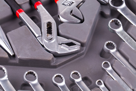 Building and measuring tools close up on the gray background photo