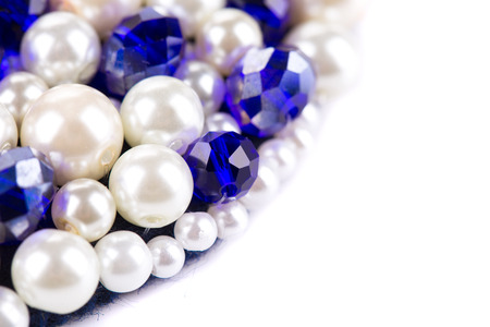 strass: White pearl and blue strass. Half background is white.