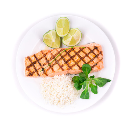Grilled salmon filler with risotto. Isolated on a white background. photo