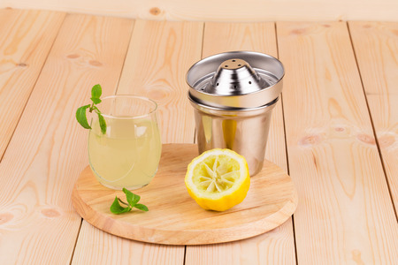 fresh lemonade on the wooden background in closeup photo