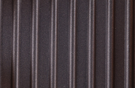 stovetop: corrugated surface metal texture in closeup as background Stock Photo