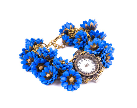 Handmade watch with blue flowers. Isolated on a white background. photo