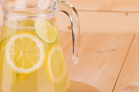 Fresh lemonade on the wooden desk closeup photo