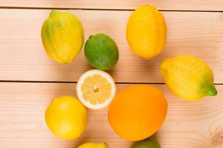 Colorful festive assortment of halved citrus fruit arranged on a wooden board photo