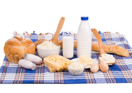Composition with bread milk and cheese Isolated on white background. photo